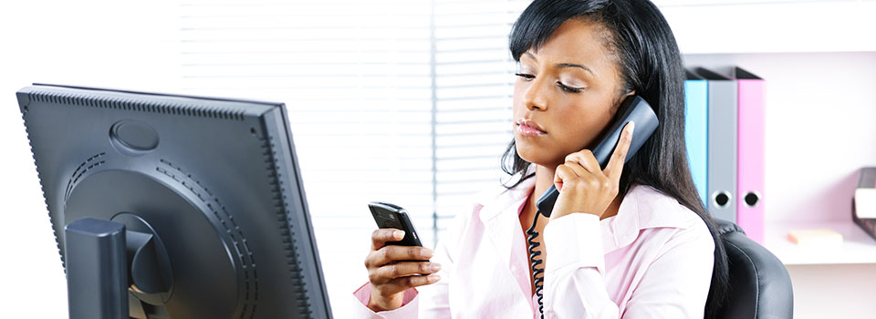 Woman using smart phone, requiring mobile forensics services